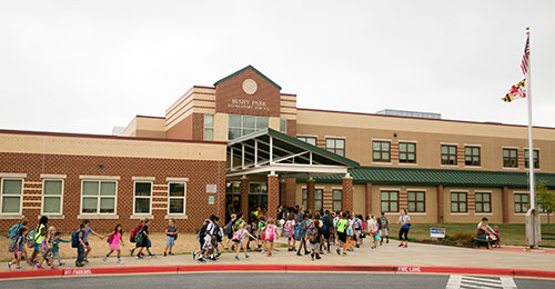 Students entering Bushey Park Elementary School