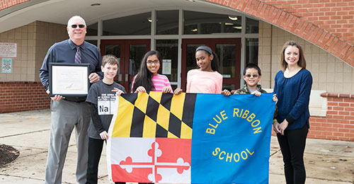 Photo of mount view middle school students with maryland blue ribbon flag