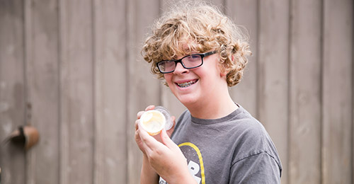 Student holding butter