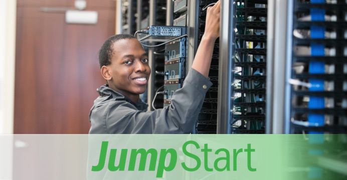 A HCPSS Student working with a server rack at HCC.