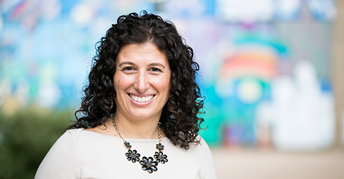 Sara Wolfson profile, sitting in classroom.