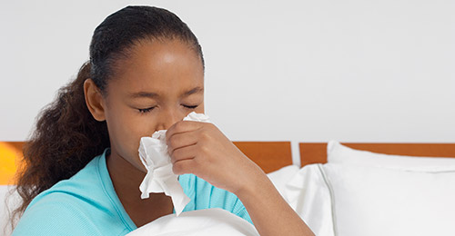 Sick student blowing nose