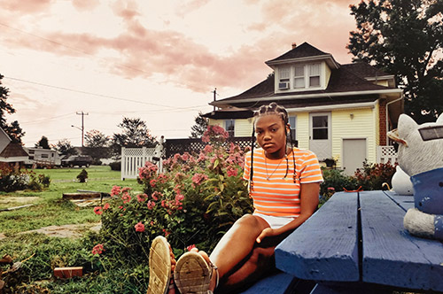 Photo of a girl sitting on a picnic table