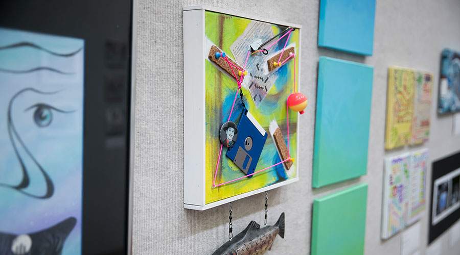 Work of art on wall at teacher gallery showcase.