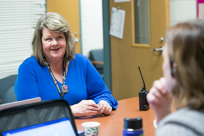Suzanne McMurtray working with fellow staff.