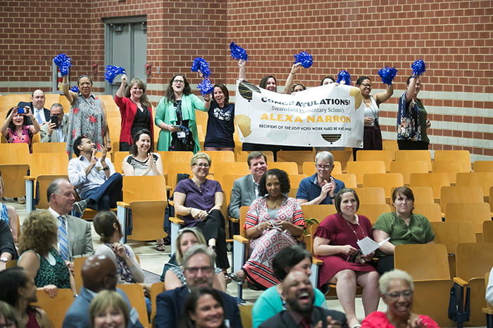 Group in an auditorium celebrates outstanding HCPSS alumni and staff.