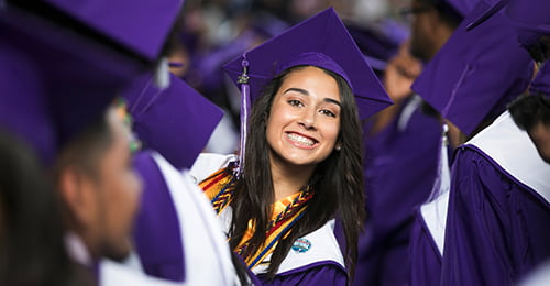 Smiling female graduate.