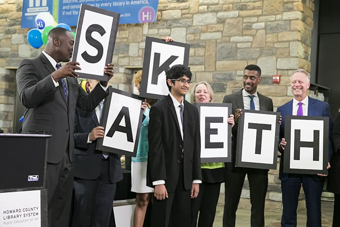 HCPSS Superintendent Matirano and others hold signs spelling out the name Saketh.