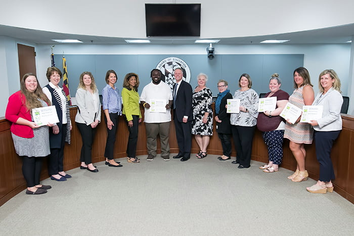 Superintendent Martirano, HCPSS Board members and several HCPSS staff hold certificates.
