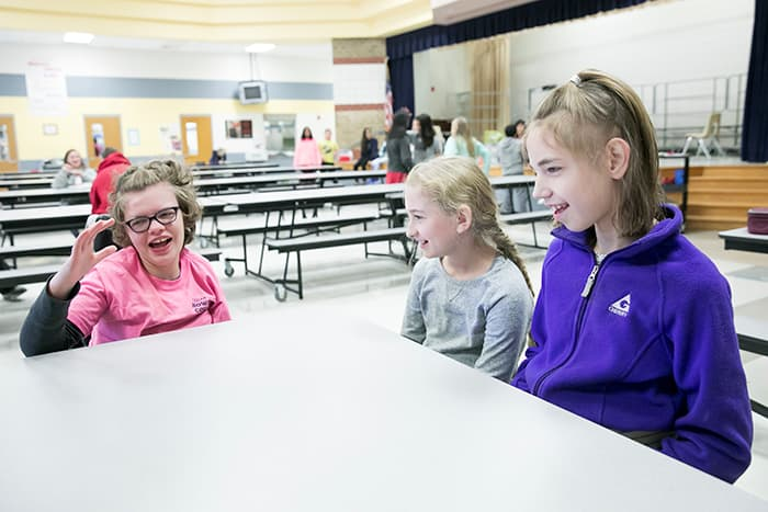 Three female students in the Folly Quarter Middle School cafeteria.