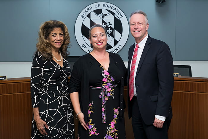 HCPSS Board Chair Mavis Ellis and Superintendent Martirano stand with Rebecca Clark.