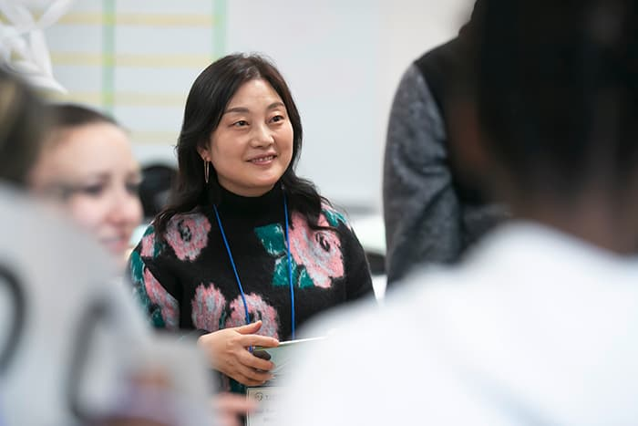Smiling female South Korean science teacher.