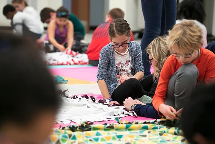 Students making blankets.