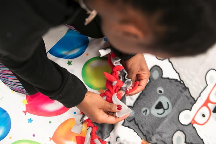A student making a blanket.