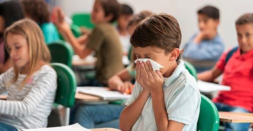 Male student sneezing.