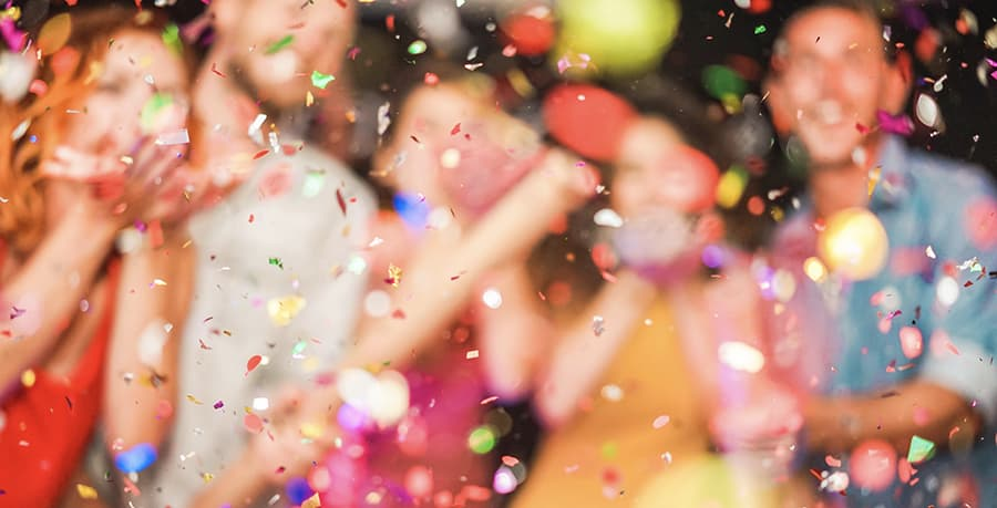 people blurred behind confetti
