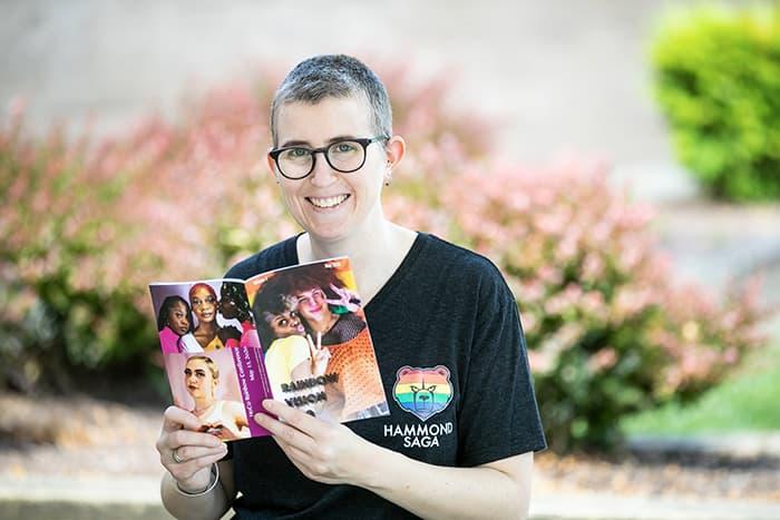 Danielle DuPuis holding a book.