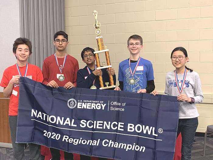 Burleigh Manor students holding a National Science Banner and trophy.