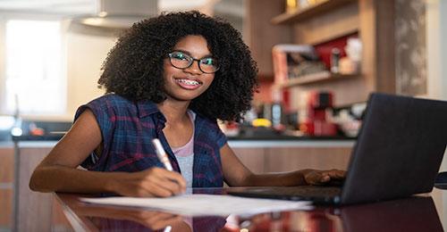 smiling teenager on laptop