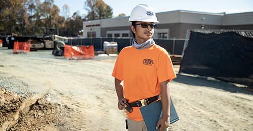 Christopher Borja stands at Hammond High School construction site.