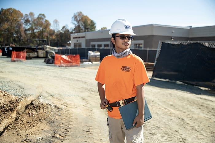 Christopher Borja stands at Hammond High School construction site.