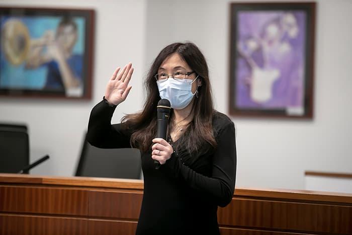 Dr. Yun Lu being sworn in.