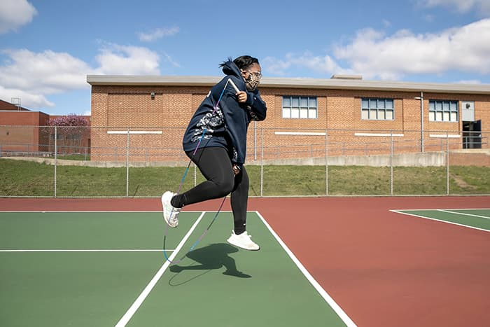 Mayah Francisco, a Howard High School JROTC student, jumping rope.