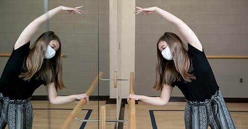 Kerry Johnson dancing at the barre.