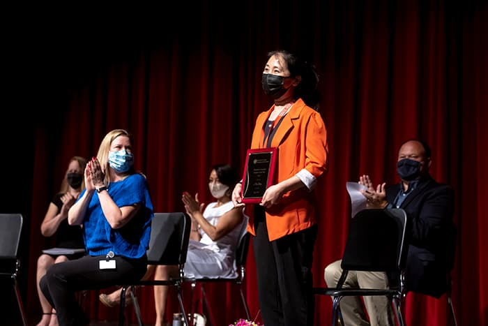 Hui Liang receiving the Maryland Language Teacher of the Year award.